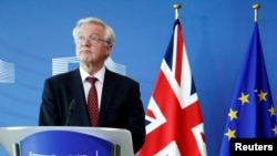 FILE - Britain's Secretary of State for Exiting the European Union David Davis looks on during a joint news conference with European Union's chief Brexit negotiator Michel Barnier (not pictured) ahead of Brexit talks in Brussels, Belgium Aug. 28, 2017.