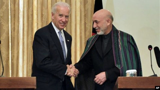 Afghan President Hamid Karzai, right, shakes hands with US Vice President Joe Biden during a press conference in Kabul, 11 Jan 2011