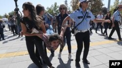 Riot police officers detain a protester during the trial of two Turkish educators, who went on a hunger strike over their dismissal under a government decree following last year's failed coup, outside a courthouse in Ankara, Turkey, Sept. 14, 2017.