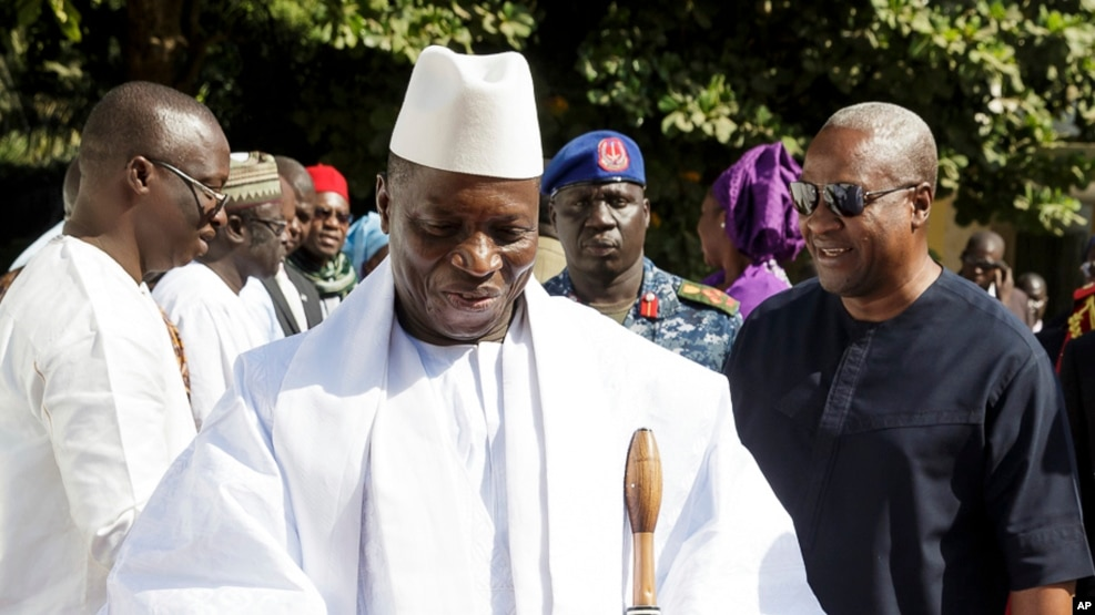 FILE - In this photo released by the Nigeria State House, Gambia's Yahya Jammeh, walk along side with Nigeria President Muhammadu Buhari (not seen), upon arrival in Banjul, Jan.13, 2017.