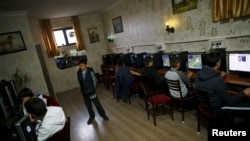 FILE - People use computers at an internet cafe in Ankara, April 6, 2015. The website of Russia's news agency Sputnik has been blocked in Turkey, in another indication of strained relations between the two countries.