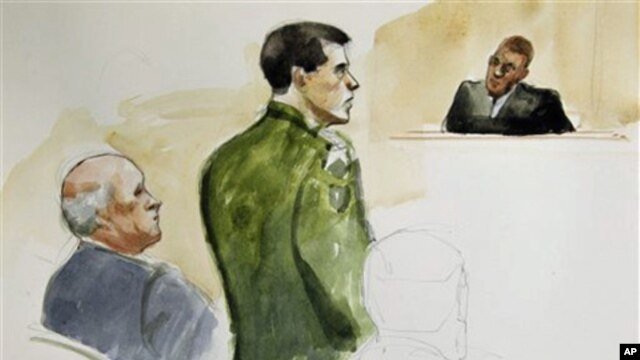 In this courtroom sketch made Wednesday, March 23, 2011, Spc. Jeremy Morlock, center, of Wasilla, Alaska, is shown with his attorney, left, and Military Judge Lt. Col. Kwasi Hawks, right during a court martial at Joint Base Lewis-McChord in Washington sta