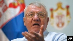 Serbia's extreme nationalist leader Vojislav Seselj speaks during a press conference in Belgrade, Serbia, Dec. 7, 2017.