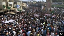 Thousands of Pakistani mourners attend a funeral procession for victims of a bombing Friday in Shikarpur, some 500 kilometers (310 miles) north of Pakistan's port city of Karachi, Jan. 31, 2015.