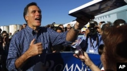 Republican presidential candidate and former Massachusetts Governor Mitt Romney greets audience members at a campaign rally in Panama City, Florida January 28, 2012.
