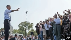 President Barack Obama waves to supporters after speaking at Fort Hayes Arts and Academic High School in Columbus, Ohio, September 13, 2011.