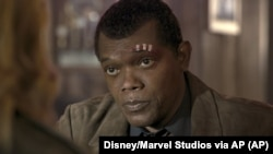 "This image released by Disney-Marvel shows Samuel L. Jackson as a younger Nick Fury in a scene from the film ""Captain Marvel."""