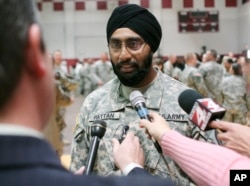 FILE - U.S. Army Capt. Tejdeep Singh Rattan speaks to journalists at a U.S. Army officer basic training graduation ceremony at Fort Sam Houston in San Antonio, March 22, 2010. Rattan was the first Sikh allowed to complete officer basic training while wearing the traditional turban and full beard since the Army altered the dress code, which had made exceptions for Sikh soldiers, in 1984.