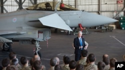 British Defense Minister Michael Fallon talks to British pilots and soldiers at RAF Akrotiri, a British air base near Limassol, Cyprus, Dec. 5, 2015. British warplanes at RAF Akrotiri carried out airstrikes in Syria Thursday.
