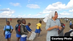 A Roman Catholic sister caught in action with children in Mashonaland West Province