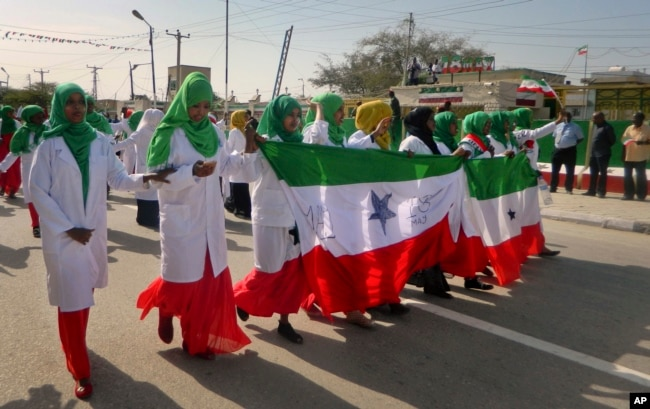 FILE - Women march in a procession to celebrate the 25th anniversary of proclaimed independence in the capital Hargeisa, Somaliland, a breakaway region of Somalia, May 18, 2016.