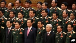 Vietnamese President Truong Tan Sang, front row left, Prime Minister Nguyen Tan Dung, front row third left, and Communist Party General Secretary Nguyen Phu Trong, front row third right, pose for a group photo with the Army generals after the election for the new Central Committee in Hanoi, Vietnam, Tuesday, Jan. 26, 2016.