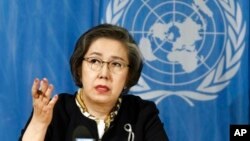 FILE - Yanghee Lee, Special Rapporteur on the situation of human rights in Myanmar, delivers her report during the 34th session of the Human Rights Council, at the European headquarters of the United Nations in Geneva, Switzerland, March 13, 2017.