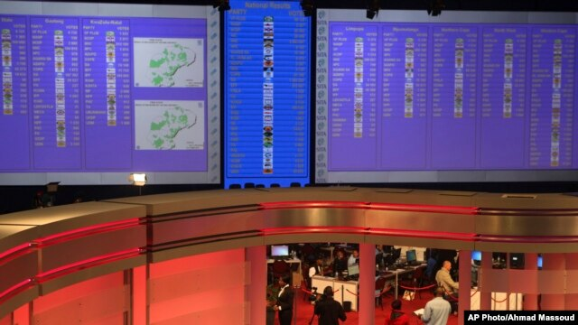 Early results of South African elections are displayed on electric boards at the Independent Electoral Commission Results Center, in Pretoria, South Africa, Thursday, May 8, 2014. Results released by the national election commission showed the African Nat