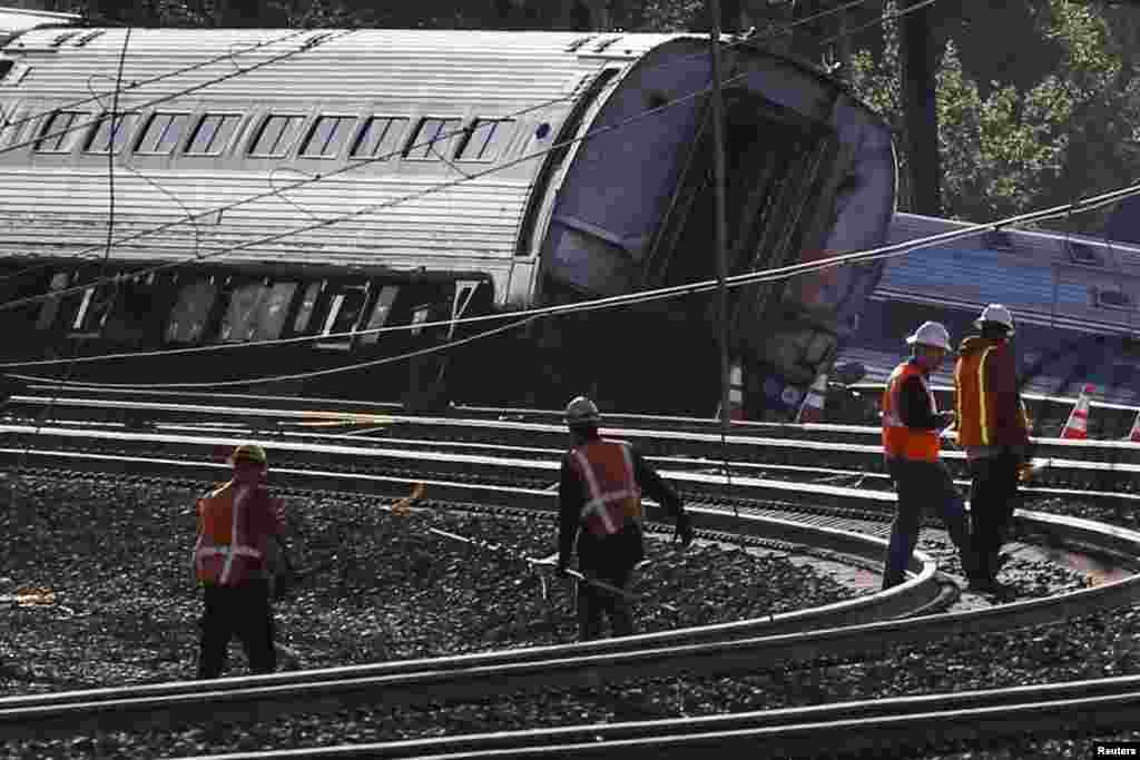 Officials survey the site of a derailed Amtrak train in Philadelphia, May 13, 2015.
