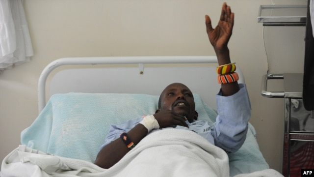 An injured Kenyan policeman lies on a hospital bed in Nairobi on November 11, 2012 recounting how he an others were attacked in Baragoi, Samburu North District.
