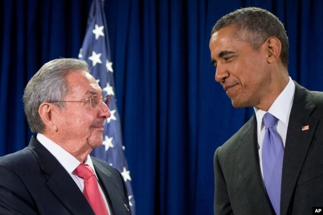 FILE - Cuban President Raul Castro, left, and U.S. President Barack Obama talks before a bilateral meeting at the United Nations headquarters in New York, Sept. 29, 2015.
