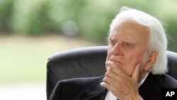 Billy Graham listens during a dedication ceremony for the Billy Graham Library in Charlotte, N.C., May 31, 2007.