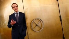 Germany's federal reserve Bundesbank President Jens Weidmann stands beside the door of a giant safe as he poses for a photograph at the money museum next to the Bundesbank headquarters, in Frankfurt, Germany, May 17, 2013.