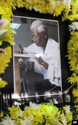 A portrait of Vann Nath, an artist who survived Khmer Rouge prison, is displayed on an altar during his funeral in Phnom Penh, Cambodia, Tuesday, Sept. 6, 2011. Vann Nath, who was among only seven people to survive Cambodia's most notorious prison of the
