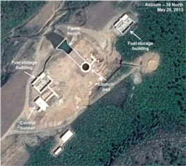 This May 26, 2013 satellite image taken by Astrium, and annotated and distributed by 38 North shows an unfinished new launch pad, center, at the Tonghae facility in North Korea. (AP Photo/Astrium - 38 North)