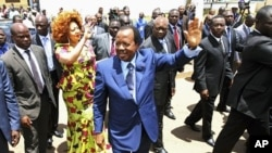 Cameroon's President Paul Biya waves outside a polling center after casting his vote in the capital Yaounde October 9, 2011.