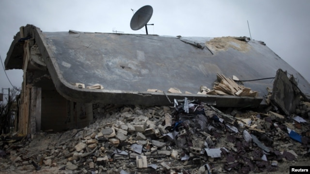 A house in Azaz destroyed by Syrian government rockets according to local residents, December 18, 2012. (Reuters)