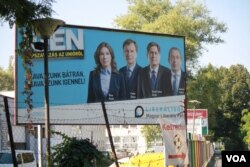 """This billboard, by one the country's farthest left parties, in Budapest, says, """"Vote bravely. Vote 'Yes.'"""" Sept. 30, 2016. (H. Murdock/VOA)"""