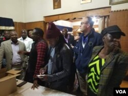 MDC Alliance members, including one of the principals Welshman Ncube at the election center in Bulawayo.