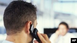 File - A man uses his cell phone.