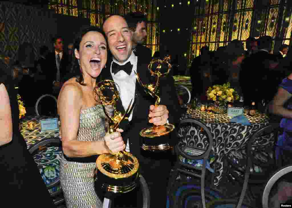 Julia Louis-Dreyfus, winner of the Best Actress in a Comedy Series, and Tony Hale, winner of the Best Supporting Actor in a Comedy Series, celebrate at the 65th Primetime Emmy Awards HBO after party in West Hollywood, Sept. 22, 2013.