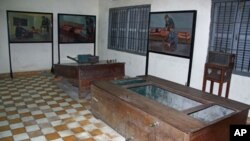 Paintings by human rights icon and artists Vann Nath depicting how torture devices were used hang on the walls of Tuol Sleng Prison in Phnom Penh, Cambodia, June 2011.