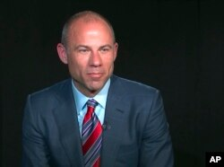 In this image from video, Michael Avenatti, attorney and spokesperson for adult film star Stormy Daniels, listens to a reporter's question during an interview in New York, March 21, 2018.