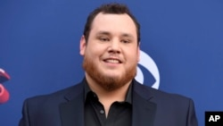 Luke Combs arrives at the 53rd annual Academy of Country Music Awards at the MGM Grand Garden Arena, April 15, 2018, in Las Vegas.