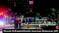 Polisi bekerja di tempat kejadian setelah suara tembakan terdengar di pusat kota Austin, Texas, pada 31 Juli 2016. (Foto: AP/Ricardo B.Brazziell/Austin American-Statesman)