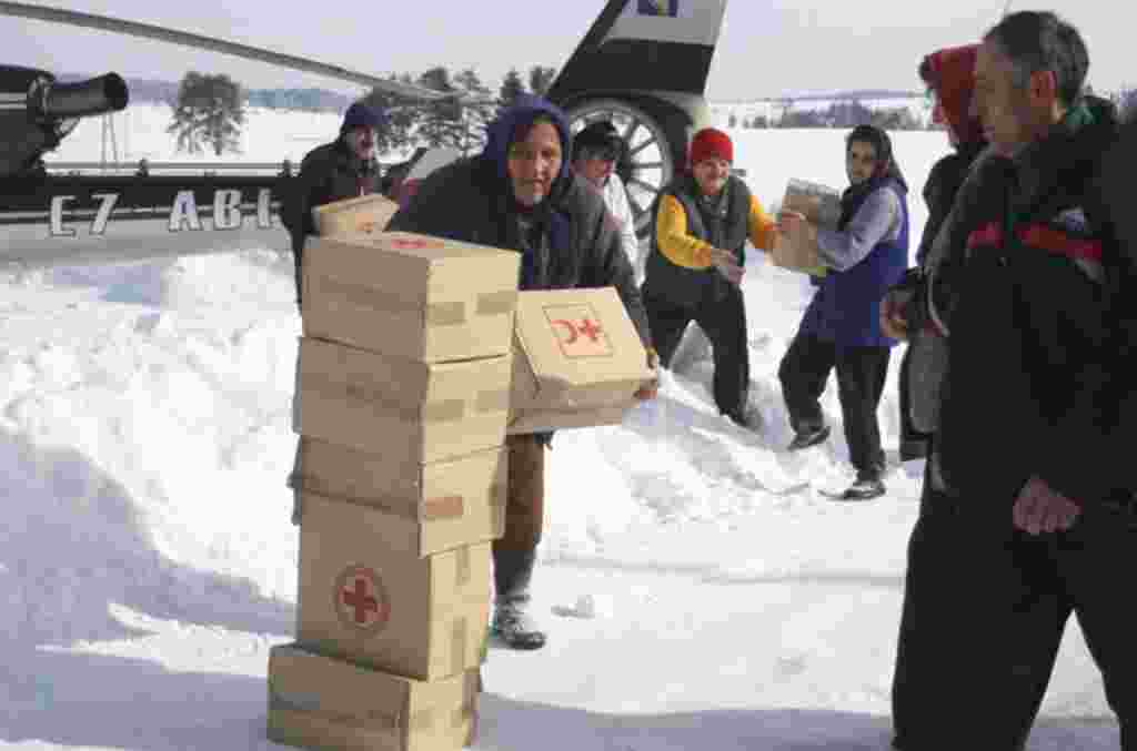 Bosnian people carrying food supplies in a remote village, cut of by road due high snow fall, near Bosnian town of Sokolac, 70 kms east of Sarajevo, Bosnia, on February 1, 2012. (AP)