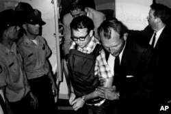 James Earl Ray being transported in Memphis, Tennessee, in this 1968 photo released by the Shelby County Register's office, March 31, 2011.