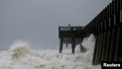 Waves crash along a pier as Hurricane Michael approaches Panama City Beach, Florida, Oct. 10, 2018.