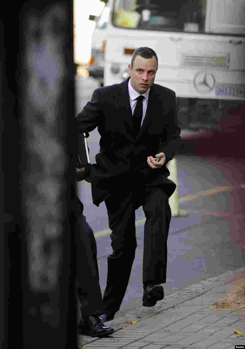 Olympic and Paralympic track star Oscar Pistorius arrives for his trial, at the North Gauteng High Court in Pretoria, May 20, 2014.