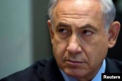 Israel's Prime Minister Benjamin Netanyahu attends the weekly cabinet meeting in Tel Aviv, June 15, 2014.