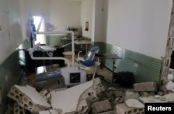 FILE - Damage at a hospital is seen after an airstrike in Deir al-Sharqi village in Idlib province, Syria, April 27, 2017.