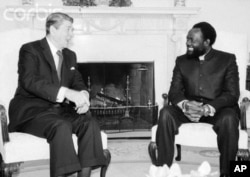 FILE - Jonas Savimbi, right, meets with U.S. President Ronald Reagan at the White House in 1985.
