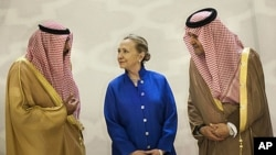 Saudi Foreign Minister Prince Saud Al-Faisal, right, US Secretary of State Hillary Clinton and Kuwaiti Foreign Minister Sheikh Sabah Khaled al-Hamad Al-Sabah chat before a US- Gulf Cooperation Council forum at the Gulf Cooperation Council Secretariat in R