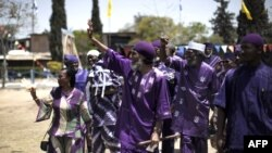FILE - Ben Ami Ben Israel (C), spiritual leader of African Hebrews, is seen with followers at a celebration May 26, 2010, in the southern Israeli town of Dimona.
