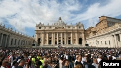 The faithful gather in front of St. Peter's Basilica as Pope Francis leads the Regina Coeli prayer in Saint Peter's Square at the Vatican, Sept. 17, 2017.