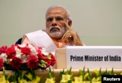FILE - India's Prime Minister Narendra Modi attends an event organized by the Christian community to celebrate the beatification of two Indians by Pope Francis late last year, in New Delhi, Feb. 17, 2015.