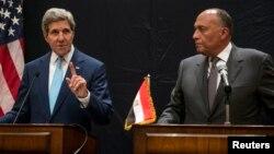 6月22日美國國務卿克里(左)與埃及外長舉行聯合記者會