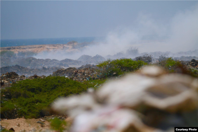 Smoke rises from piles of garbage dumped on Jazeera Beach, in Somalia's capital, Mogadishu. (Courtesy - Jamal Ali)
