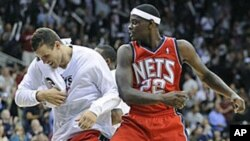 New Jersey Nets' Anthony Morrow, right, celebrates with teammate Kris Humphries after hitting a game-winning three-point shot in a game against the Detroit Pistons, 27 Oct 2010