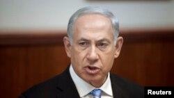 FILE - Israel's Prime Minister Benjamin Netanyahu attends the weekly cabinet meeting in Jerusalem. Oct. 27, 2013.